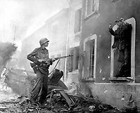 &quot;Finally, I got me a 'souvenir.'  Somehow the Jerries I got in my sights always seemed to have bad luck.  Then one day in Illy, France, I spotted an officer inside a battered building and I yelled for him to come on out.  He did.&quot;  Ca. September 1944.  Army. (OWI)<br /> Exact Date Shot Unknown<br /> NARA FILE #:  208-YE-54<br /> WAR &amp; CONFLICT BOOK #:  1053