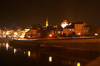 View over the Old Town Bergerac over the river Dordogne at night Bergerac Dordogne France