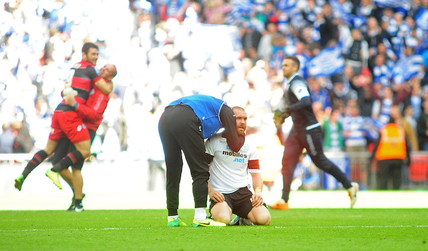 Derby County's Jake Buxton is consoled by a team-mate at the final whistle <br /> <br /> Photographer Chris Vaughan/CameraSport<br /> <br /> Football - The Football League Sky Bet Championship Play-Off Final - Derby County v Queens Park Rangers - Saturday 24th May 2014 - Wembley Stadium - London<br /> <br /> &copy; CameraSport - 43 Linden Ave. Countesthorpe. Leicester. England. LE8 5PG - Tel: +44 (0) 116 277 4147 - admin@camerasport.com - www.camerasport.com