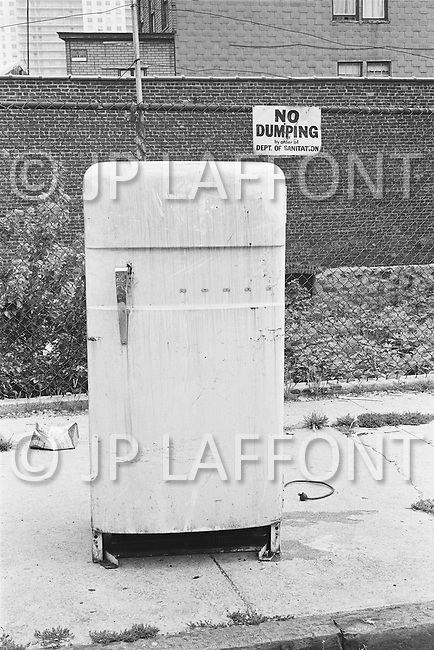 September 1967 --- Old Fridge in a New York City Street --- Image by © JP Laffont