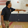Eric Rubin, MacArthur varsity boys basketball head coach, calls out to his team during a game against Hjemly (Ringe, Denmark) in the Jeff Shaw Memorial Basketball Tournament at MacArthur High School on Thursday, Dec. 1, 2016. MacArthur won 65-43.