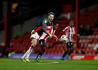4th January 2020; Griffin Park, London, England; English FA Cup Football, Brentford FC versus Stoke City; Nick Powell of Stoke City challenges Joel Valencia of Brentford - Strictly Editorial Use Only. No use with unauthorized audio, video, data, fixture lists, club/league logos or 'live' services. Online in-match use limited to 120 images, no video emulation. No use in betting, games or single club/league/player publications