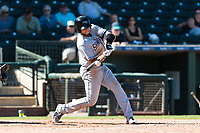 Peoria Javelinas third baseman Hudson Potts (13), of the San Diego Padres organization, swings at a pitch during an Arizona Fall League game against the Surprise Saguaros at Surprise Stadium on October 17, 2018 in Surprise, Arizona. (Zachary Lucy/Four Seam Images)