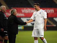 (L-R) Brian Flynn greets James Thomas during the Alan Tate Testimonial Match, Swansea City Legends v Manchester United Legends at the Liberty Stadium, Swansea, Wales, UK