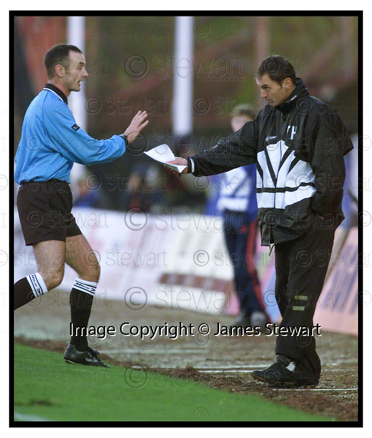 4th December 1999          Copyright Pic : James Stewart .Ref :                           .File Name : stewart10-st mirren v falkirk                        .ST MIRREN MANAGER TOM HENRIE IS SPOKEN TO BY REF MIKE MCCURRY......Payments to :-.James Stewart Photo Agency, Stewart House, Stewart Road, Falkirk. FK2 7AS      Vat Reg No. 607 6932 25.Office : +44 (0) 1324 630007        Mobile : 07721 416997.Fax     : +44 (0) 1324 630007.E-mail : jim@jspa.co.uk.If you require further information then contact Jim Stewart on any of the numbers above.........