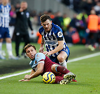 1st February 2020; London Stadium, London, England; English Premier League Football, West Ham United versus Brighton and Hove Albion; Mark Noble  of West Ham United holds on to the ball under pressure from Pascal Gross of Brighton and Hove Albion