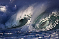 World famous shore break winter waves (20+ foot) at Waimea Bay on the North Shore of Oahu, Hawaii.