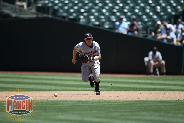 OAKLAND, CA - JUNE 6:  Brendan Harris #23 of the Minnesota Twins chases a ground ball at first base during the game against the Oakland Athletics at the Oakland-Alameda County Coliseum on June 6, 2010 in Oakland, California. Photo by Brad Mangin
