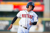 Andy Sugilio (15) of the Billings Mustangs hustles towards third base against the Missoula Osprey at Dehler Park on August 21, 2017 in Billings, Montana.  The Osprey defeated the Mustangs 10-4.  (Brian Westerholt/Four Seam Images)