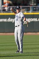 Lake County Captains outfielder Jordan Smith #39 throws prior to the game against the Dayton Dragons at Fifth Third Field on June 25, 2012 in Dayton, Ohio. Lake County defeated Dayton 8-3. (Brace Hemmelgarn/Four Seam Images)