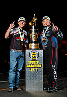 Nov 17, 2019; Pomona, CA, USA; NHRA top fuel driver Steve Torrence (left) and funny car driver Robert Hight pose for a portrait with the championship trophy after winning the 2019 world championship at the Auto Club Finals at Auto Club Raceway at Pomona. Mandatory Credit: Mark J. Rebilas-USA TODAY Sports