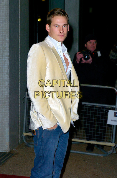 "LEE RYAN.Arrives at ""An Audience With Take That"".at The London Television Studios,.London, England, December 2nd 2006..half length cream jacket jeans.CAP/CAN.©Can Nguyen/Capital Pictures"