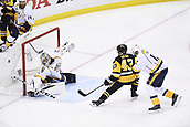 8th June 2017, Pittsburgh, PA, USA; Pittsburgh Penguins left wing Conor Sheary (43) scores past Nashville Predators goalie Juuse Saros (74) during the second period in Game Five of the 2017 NHL Stanley Cup Final between the Nashville Predators and the Pittsburgh Penguins on June 8, 2017, at PPG Paints Arena