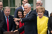 United States Vice President Mike Pence attends the signing ceremony of S. 2372 – VA Mission Act of 2018 at the White House in Washington, DC, June 6, 2018. Former US Senator Elizabeth Dole (Republican of North Carolina) stands at right.  Credit: Chris Kleponis / CNP