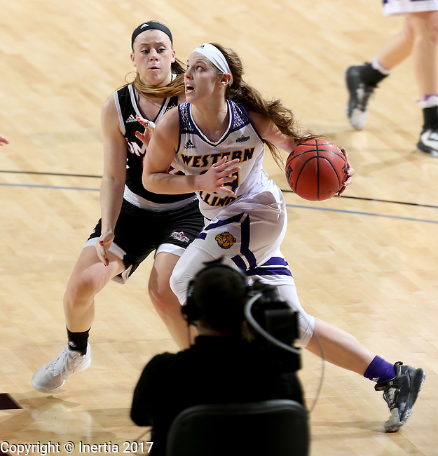 SIOUX FALLS, SD: MARCH 6: Taylor Higginbotham #24 from Western Illinois drives to the basket in front of Remy Davenport #33 from Omaha during the Summit League Basketball Championship on March 6, 2017 at the Denny Sanford Premier Center in Sioux Falls, SD. (Photo by Dave Eggen/Inertia)