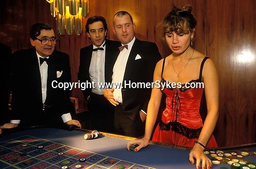 Mayfair, London. 1990's<br /> Three would be high rollers to chance their luck at the roulette table at a SPARKS charity fund raising ball at the London Hilton Hotel.