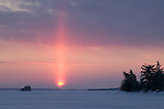 sun pillar over frozen  Rainy Lake, Voyageurs National Park, Minnesota