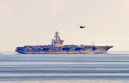 A Blackhawk helicopter flies near the nuclear powered United States Navy aircraft carrier USS Nimitz (CVN-68) which was on patrol in the Ionian Sea on Friday, October 25, 2013.  The photo was taken from the cruise ship Celebrity Equinox that was in the Ionian Sea en route to Kotor, Montenegro.<br /> Credit: Ron Sachs / CNP