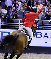 OMAHA, NEBRASKA - MAR 31: McLain Ward celebrates after winning the FEI World Cup Jumping Final II aboard HH Azur at the CenturyLink Center on March 31, 2017 in Omaha, Nebraska. (Photo by Taylor Pence/Eclipse Sportswire/Getty Images)