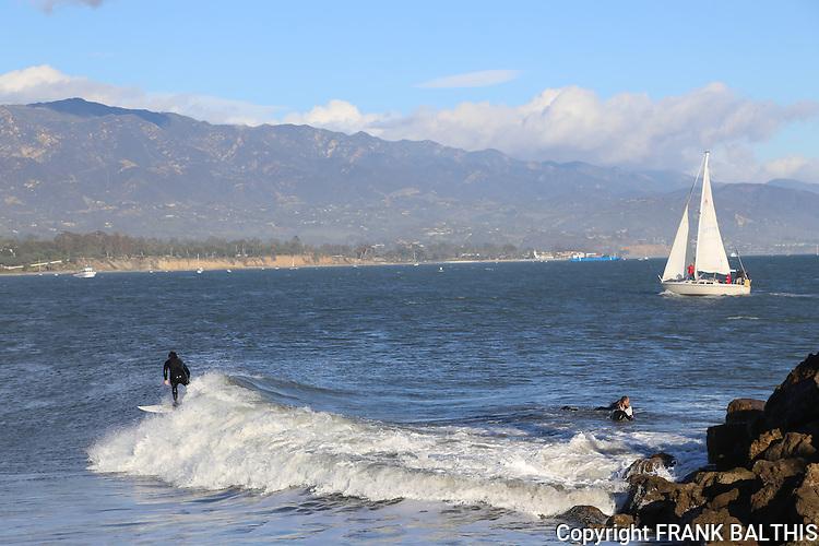 Surfing and sailing near Santa Barbara Harbor