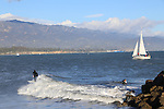 Surfing and sailing near Santa Barbara Harbor