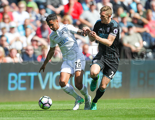 May 21st 2017, Liberty Stadium, Swansea Wales;  EPL Premier league football, Swansea versus West Bromwich Albion; Kyle Naughton of Swansea City (L) and Darren Fletcher (Captain) of West Bromwich Albion (R) battle for possession during the match