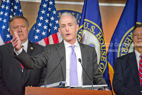 United States Representative Trey Gowdy (Republican of South Carolina), Chairman, US House Select Committee on the Events Surrounding the 2012 Terrorist Attack in Benghazi, Libya, answers a reporter's question during a press conference in the US Capitol in Washington, DC announcing the release of the committee report on Tuesday, June 28, 2016.  US Representative Mike Pompeo (Republican of Kansas) looks on from left and US Representative Lynn Westmoreland (Republican of Georgia) looks on from right.<br /> Credit: Ron Sachs / CNP