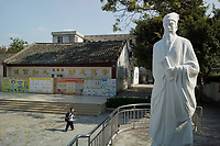 Huizhou, Guangdong province, China - A student walks past a statue of Song Dynasty Poet and politician Su Dongpo at the Su Dongpo Primary School, October 2014.