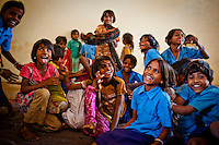 Indian village children plays at the Bal Bhavan in Palasavu village in the Dungarpur district of the Northern Indian state of Rajasthan on the 3rd of April 2011.