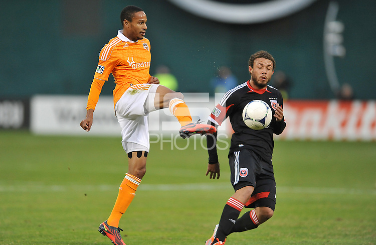 Houston Dynamo midfielder Ricardo Clark (13) goes against D.C. United midfielder Nick DeLeon (18) D.C. United tied The Houston Dynamo 1-1 but lost in the overall score 4-2 in the second leg of the Eastern Conference Championship at RFK Stadium, Sunday November 18, 2012.