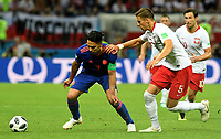 KAZAN - RUSIA, 24-06-2018: Jan BEDNAREK (Der) jugador de Polonia disputa el balón con Radamel FALCAO (Izq) jugador de Colombia durante partido de la primera fase, Grupo H, por la Copa Mundial de la FIFA Rusia 2018 jugado en el estadio Kazan Arena en Kazán, Rusia. /  Jan BEDNAREK (R) player of Polonia fights the ball with Radamel FALCAO (L) player of Colombia during match of the first phase, Group H, for the FIFA World Cup Russia 2018 played at Kazan Arena stadium in Kazan, Russia. Photo: VizzorImage / Julian Medina / Cont