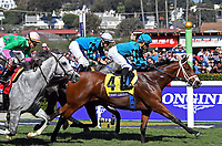 DEL MAR, CA - NOVEMBER 04: Stormy Liberal #4, ridden by Joel Rosario pulls ahead during the Breeders' Cup Turf Sprint race on Day 2 of the 2017 Breeders' Cup World Championships at Del Mar Racing Club on November 4, 2017 in Del Mar, California. (Photo by Bob Mayberger/Eclipse Sportswire/Breeders Cup)