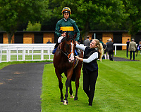 Winner of M J Church British EBF Novice Stakes (Plus 10) (Div 2),  Bullingdon ridden by Sean Levey and trained by Richard Hannon is led into the winners enclosure during Afternoon Racing at Salisbury Racecourse on 7th August 2017