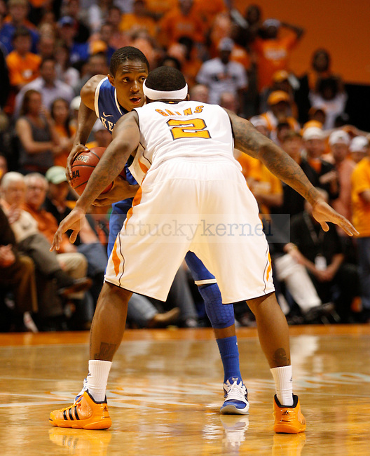 Brandon Knight looks for an open teammate over the shoulder of Melvin Goins, at Thompson-Boling Arena, on Sunday, March 6, 2011. Photo by Latara Appleby | Staff