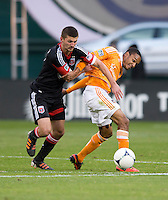 Perry Kitchen (23) of D.C. United fights for the ball with Ricardo Clark (13) of Houston Dynamo during the game at RFK Stadium in Washington,DC. D.C. United tied the Houston Dynamo, 1-1.  With the tie, Houston won the Eastern Conference and advanced to the MLS Cup.