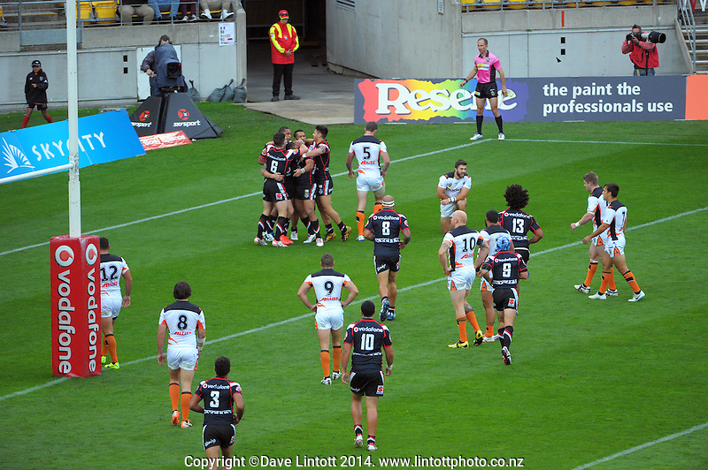 The Warriors celebrate before having a try disallowed during the NRL match between the NZ Warriors and Wests Tigers at Westpac Stadium, Wellington, New Zealand on Saturday, 29 March 2014. Photo: Dave Lintott / lintottphoto.co.nz