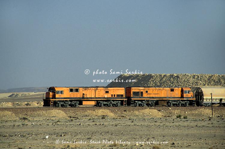 Freight train travelling through the desert, Jordan.