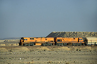 Freight train travelling through the desert, Jordan.