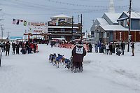 Bob Bundtzen runs up and into the finish chute in Nome on Friday March 14 during the 2014 Iditarod Sled Dog Race.<br /> <br /> PHOTO (c) BY JEFF SCHULTZ/IditarodPhotos.com -- REPRODUCTION PROHIBITED WITHOUT PERMISSION