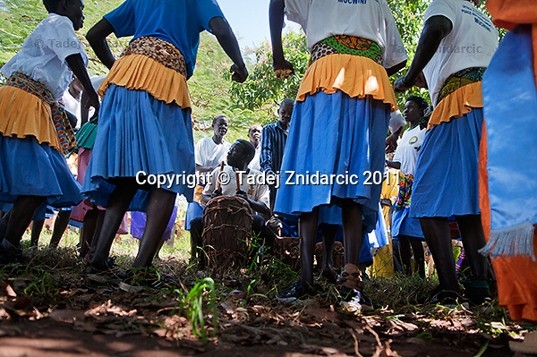 Musicians and dancers perform during 'Wang-oo' community dialog on Sexual and Gender Based Violence (SGBV) in Mucwini village, Mucwini Sub-county, Kitgum district. Mucwini is one of the villages with highest rates of SGBV in northern Uganda.