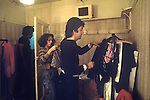 "Paul McCartney Wing Tour 1973. Wardrobe designer Paul chooseing clothes to wear. 1970s UK The photographs from this set were taken in 1975. I was on tour with them for a children's ""Fact Book"". This book was called, The Facts about a Pop Group Featuring Wings. Introduced by Paul McCartney, published by G.Whizzard. They had recently recorded albums, Wildlife, Red Rose Speedway, Band on the Run and Venus and Mars. I believe it was the English leg of Wings Over the World tour. But as I recall they were promoting,  Band on the Run and Venus and Mars in particular."