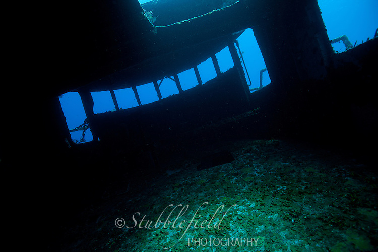 View of the bridge of the wreck of the Mr. Bud, a former shrimping boat, scuttled off the island of Roatan, Honduras and now used as a scuba diving site.