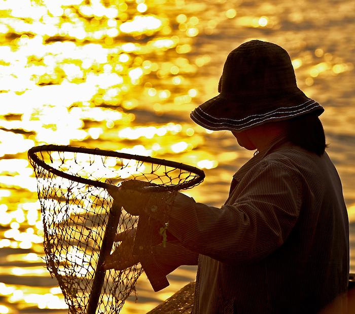 Fisherwoman at Dawn at Captree Pier