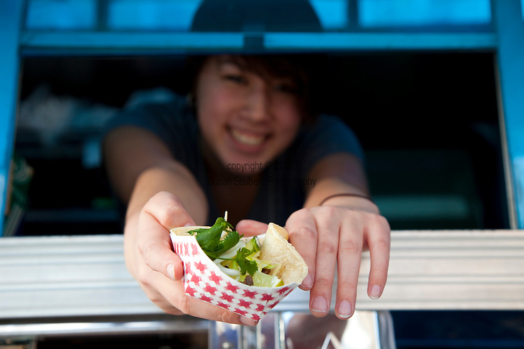 Koi Fusion, a roving Korean taco truck that tweets its locations during the day.  Their trucks serve up hot, grilled Korean-marinated meats in a traditional Mexican taco/burrito style.