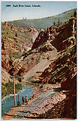 Main track curving along stream.  Train is in distance.  Sidings for loading.  See duplicate RD036-018.  &quot;1689 Eagle River Canyon, Colorado.&quot;<br /> D&amp;RG  Eagle River Canyon, CO