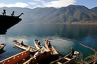 CHINA Province Yunnan Lugu Lake , ethnic minority Mosuo who are buddhist and women have a matriarch, buddhist temple on island in the Lake / CHINA Provinz Yunnan , ethnische Minderheit Mosuo am Lugu See , die Mosuo sind Buddhisten und Mosuo Frauen ueben ein Matriarchat aus, buddhistische Pagode auf Insel im See