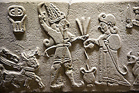 "Photo of Neo-Hittite orthostat from Karkamis, Turkey.  The meeting of the ""Storm God"" on right and a King on the left. An Ankara Museum of Anatolian Civilizations exhibit."