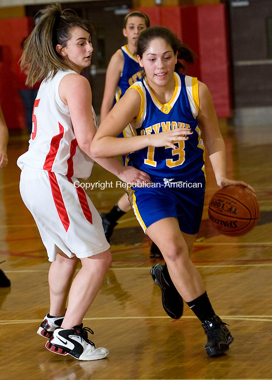 WOLCOTT, CT - 12 FEBRUARY 2009 -021209JT11-<br /> Seymour's Amber Martinez dribbles past Wolcott's Chrissie Benson during Thursday's game at Wolcott. Wolcott won, 57-30.<br /> Josalee Thrift / Republican-American