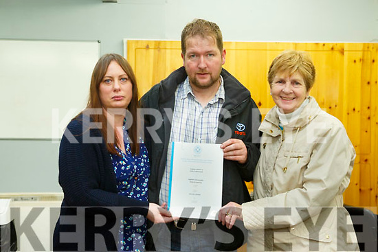 Brendan Griffin  Minister of State for Tourism and Sport presented Certificate to  trainees of the Community Training Centre Monavalley at an awards event on Monday. Pictured  are Theresa Griffin Mike Griffin and Kathleen Griffin family of Michael Griffin who past away recently, received his award
