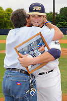 16 May 2010:  FIU's Tim Jobe (26) and his father embrace on the field prior to the game as FIU honored its seniors.  The FIU Golden Panthers defeated the University of South Alabama Jaguars, 5-0, at University Park Stadium in Miami, Florida.